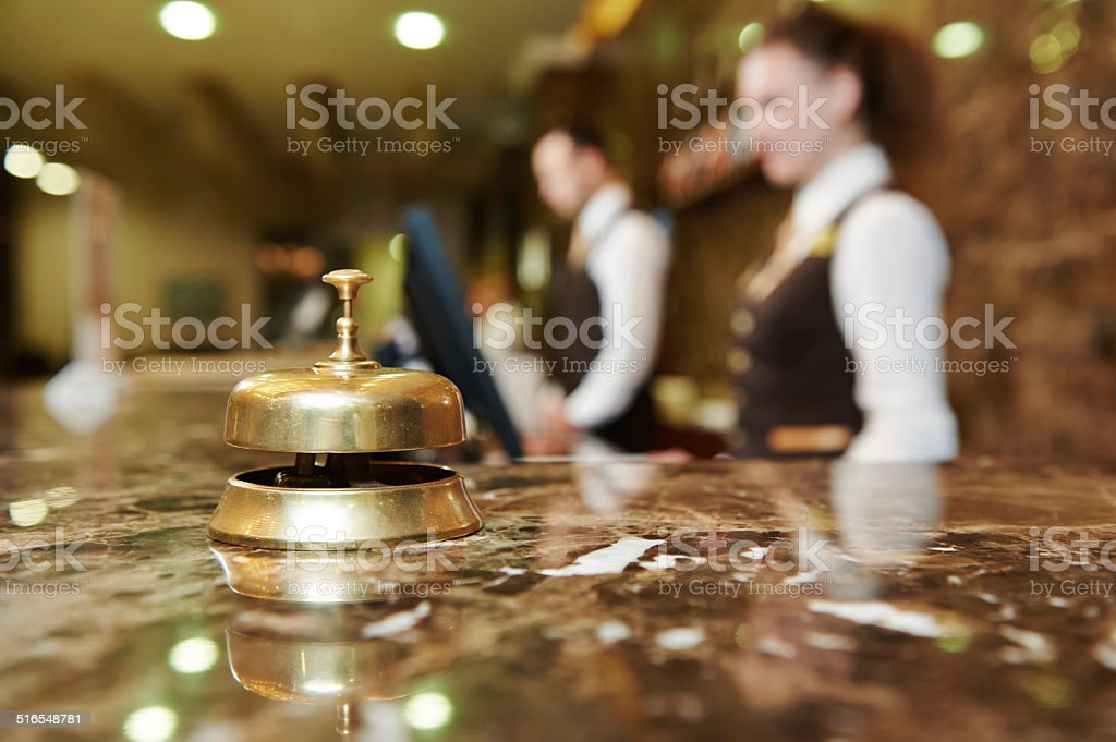 Hotel reception with bell stock photo
