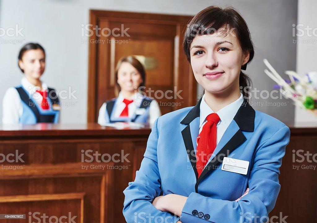 Hotel reception worker stock photo