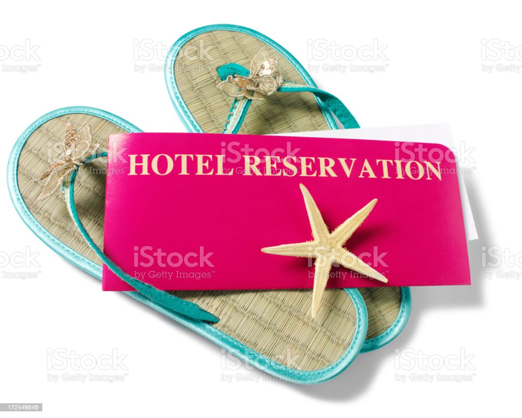 Hotel Reservation Ticket and Flip Flops royalty-free stock photo