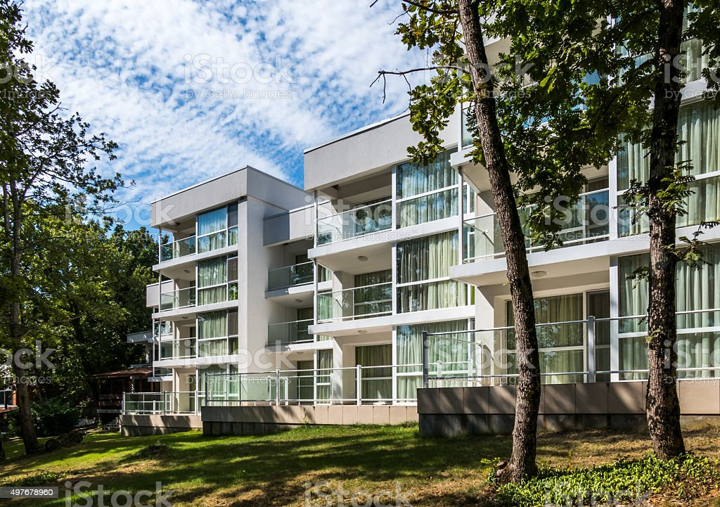 Hotel resort building with beautiful windows in nature stock photo