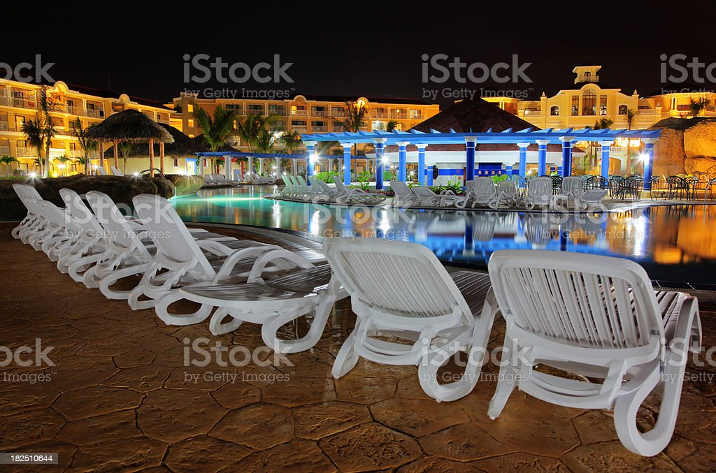 Hotel resort poolside with bar at night royalty-free stock photo