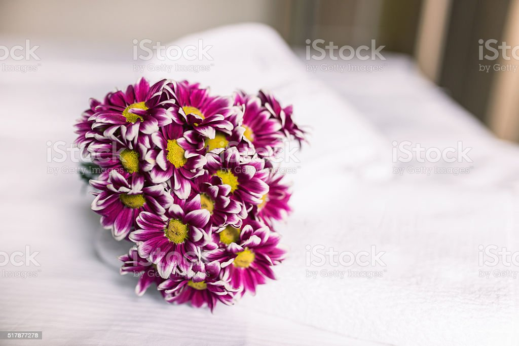 Hotel room interior, flowers on bedsheets stock photo