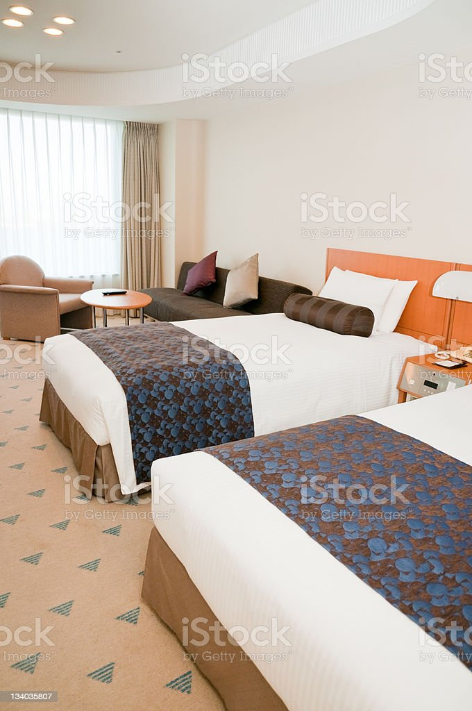 Hotel room with two beds royalty-free stock photo