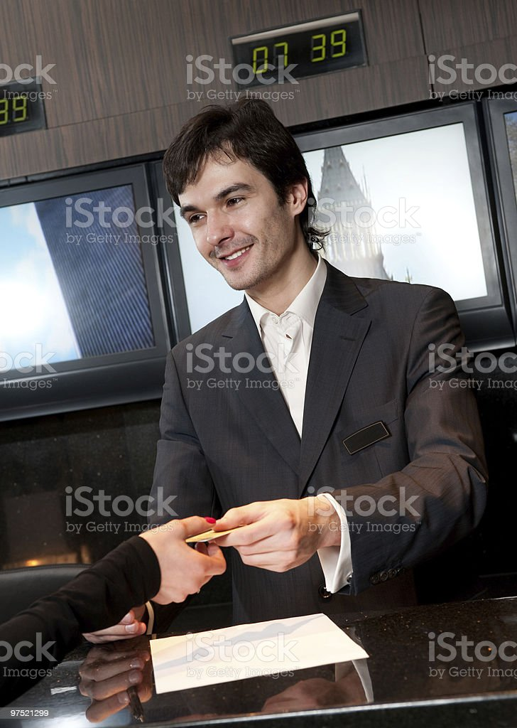Hotel salesclerk smiling at a guest royalty-free stock photo