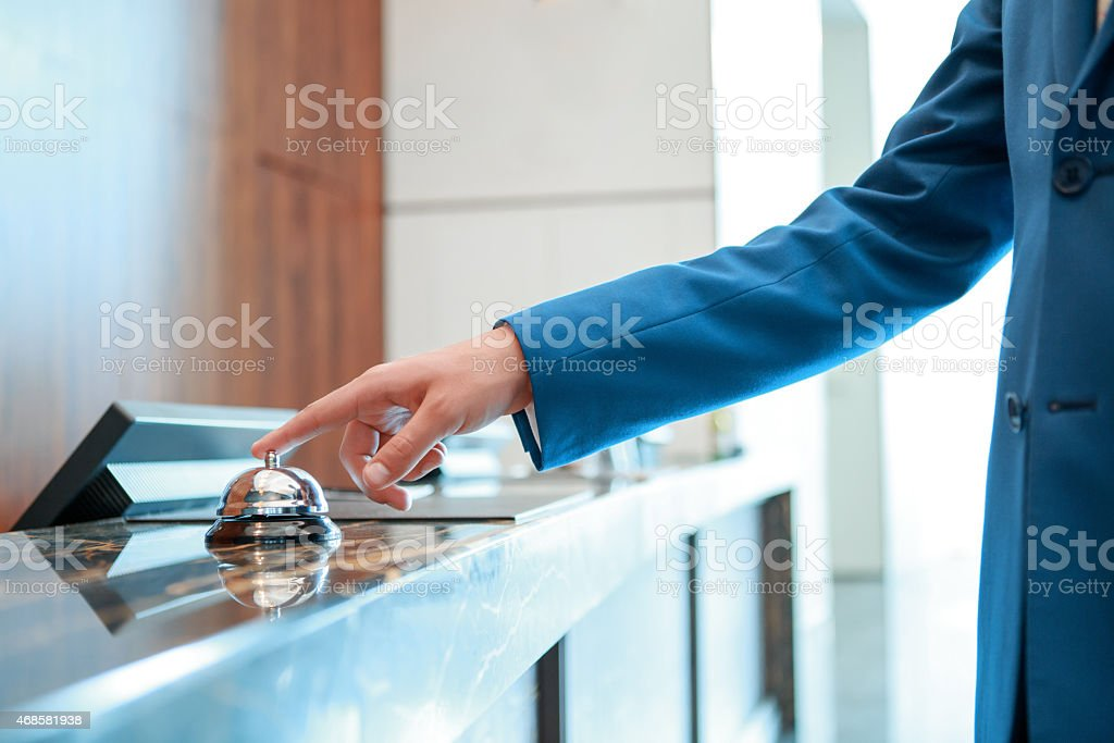 Hotel service bell at reception stock photo