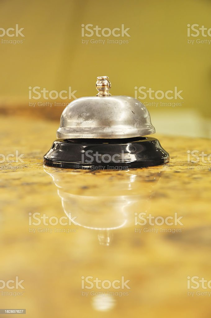 hotel service bell on a counter top royalty-free stock photo