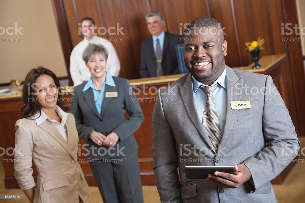 Hotel service employees in the lobby royalty-free stock photo