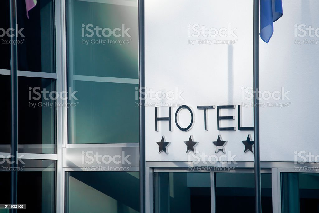 Hotel sign and four stars stock photo