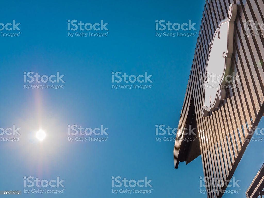 Hotel sign board under sun rays stock photo