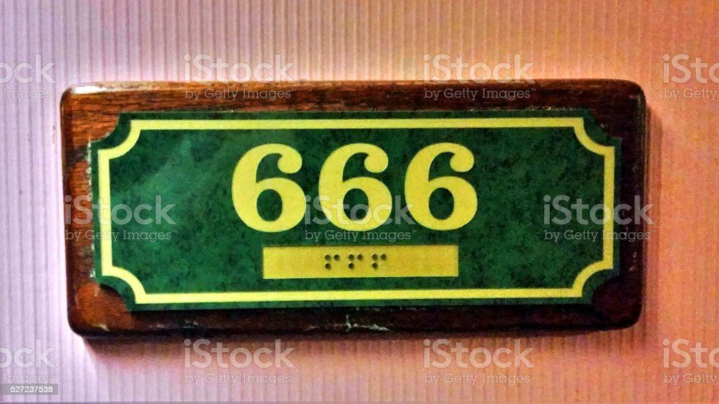 Hotel Sign for Room 666 stock photo