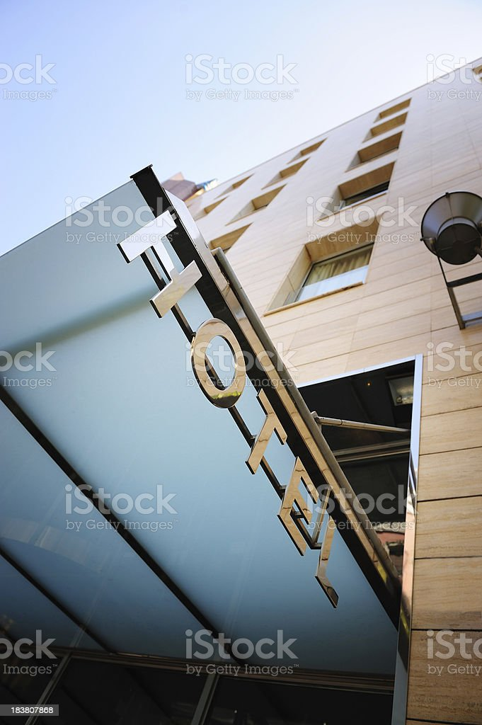 Hotel sign over building entrance stock photo