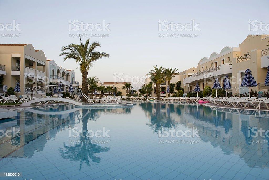 hotel swimming pool at dawn royalty-free stock photo