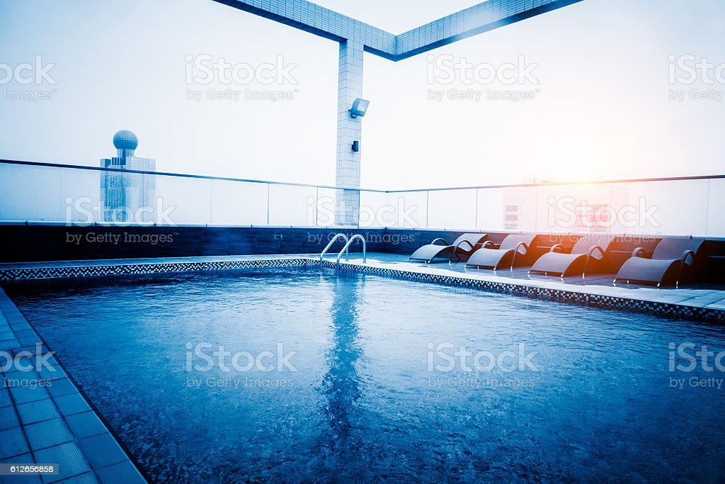 hotel swimming pool at rooftop stock photo