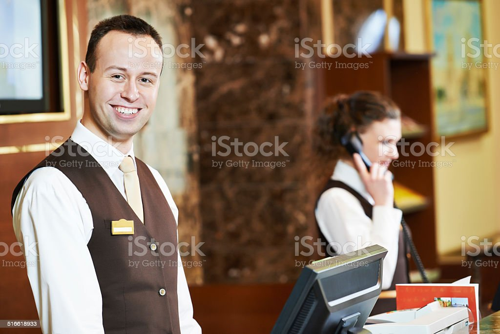 Hotel worker on reception stock photo