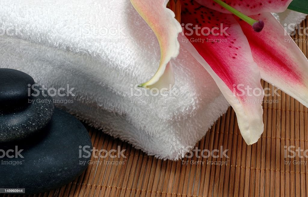 hotstones with towels and flower stock photo