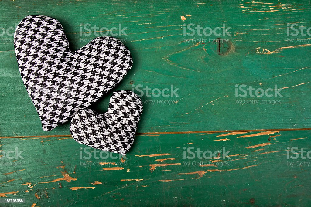 houndstooth heart on a green background stock photo