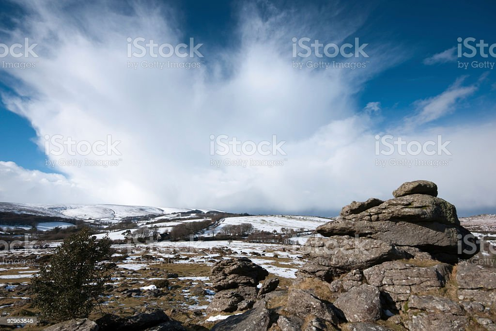 Houndtor  Dartmoor with snow and storm cloud royalty-free stock photo