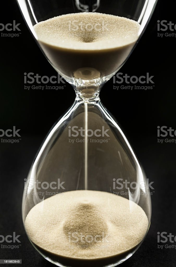 Hour Glass With Flowing Sands royalty-free stock photo