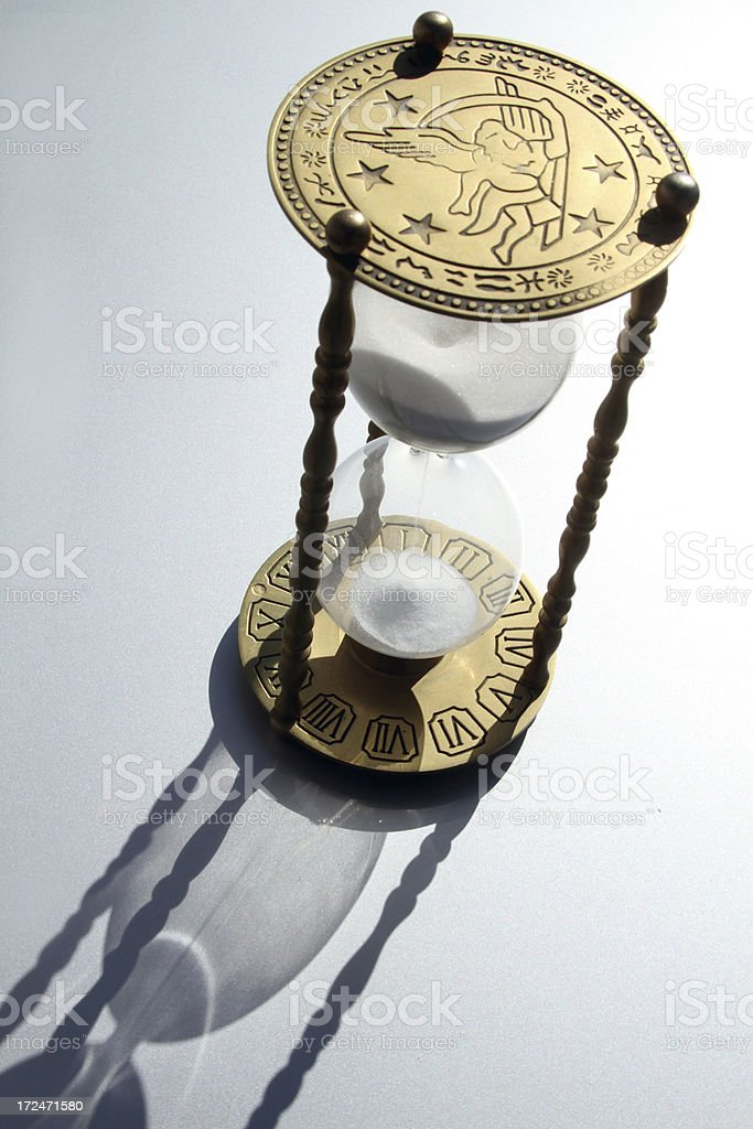 hour glass with shadow stock photo