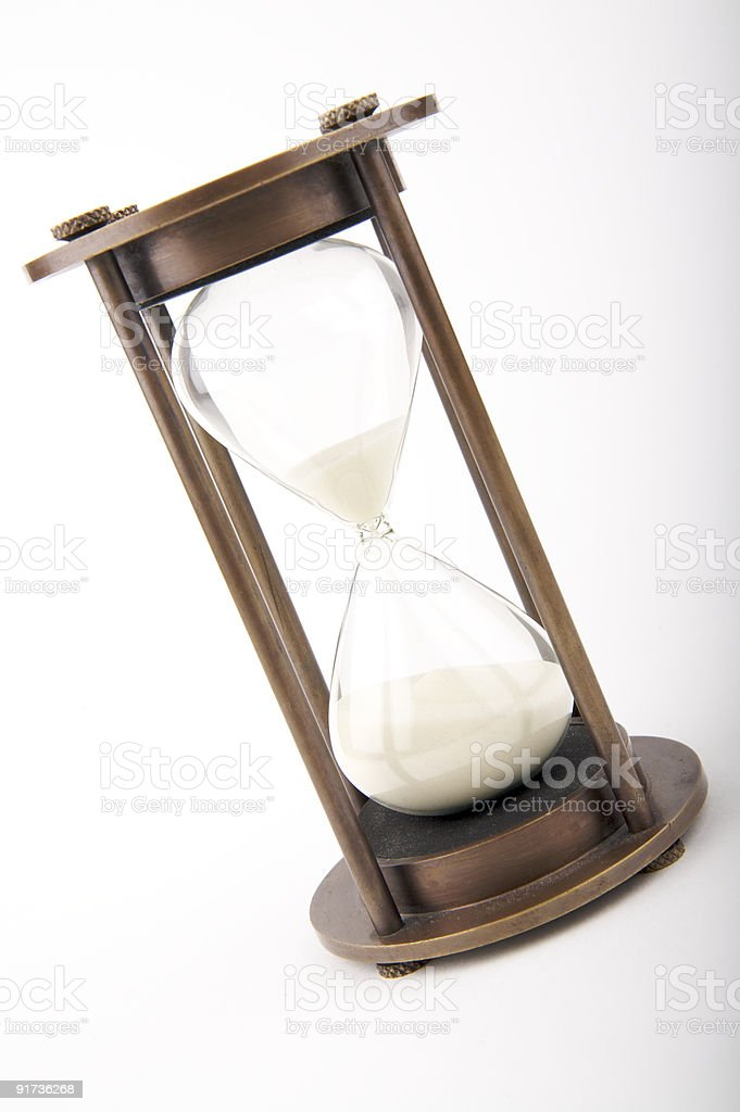 Hourglass against white background royalty-free stock photo