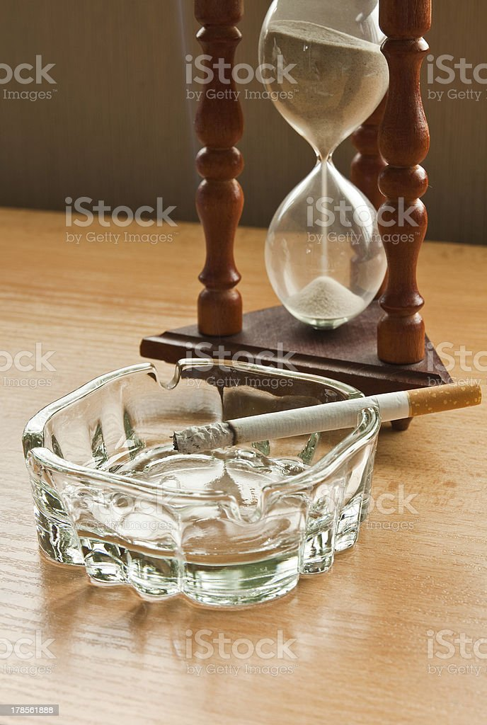 Hourglass and a cigarette royalty-free stock photo