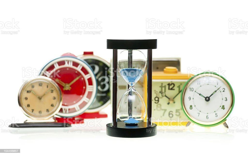 Hourglass and alarm clocks stock photo