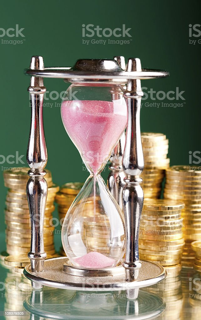 hourglass and coins royalty-free stock photo