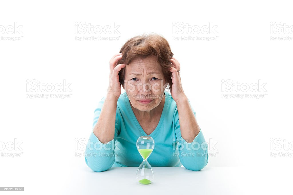 Hourglass and elderly women stock photo