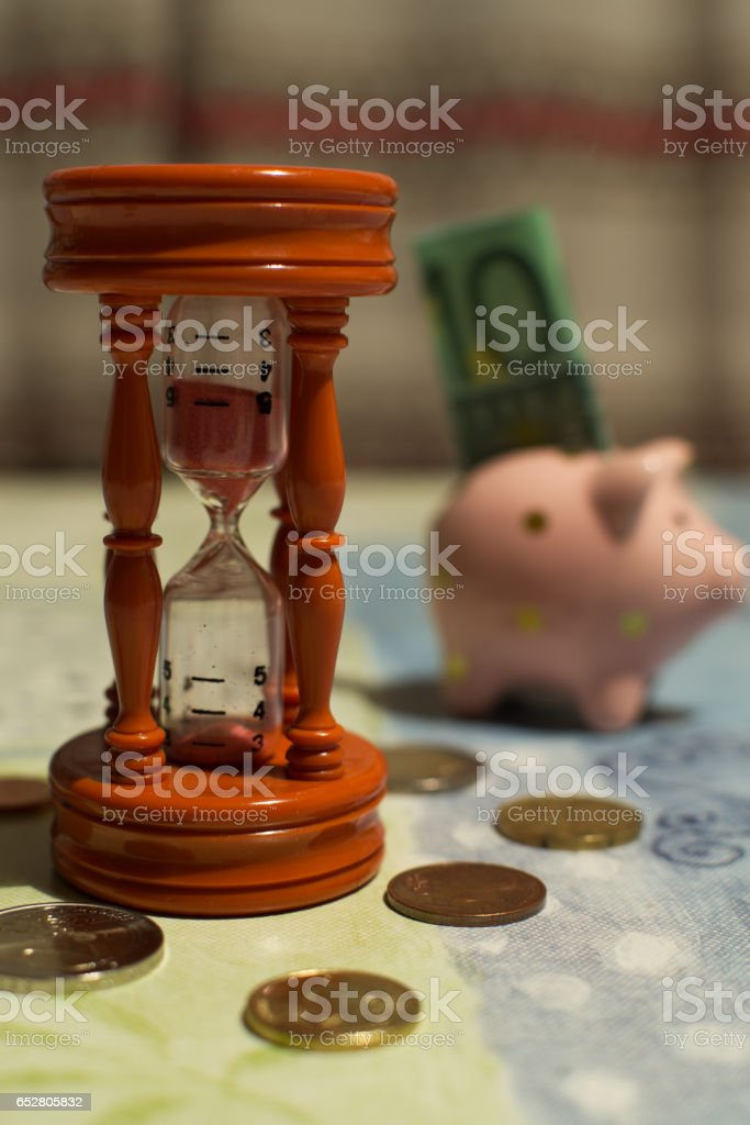 Hourglass and piggy bank - Time is money stock photo