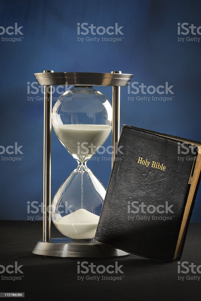 Hourglass & Bible stock photo
