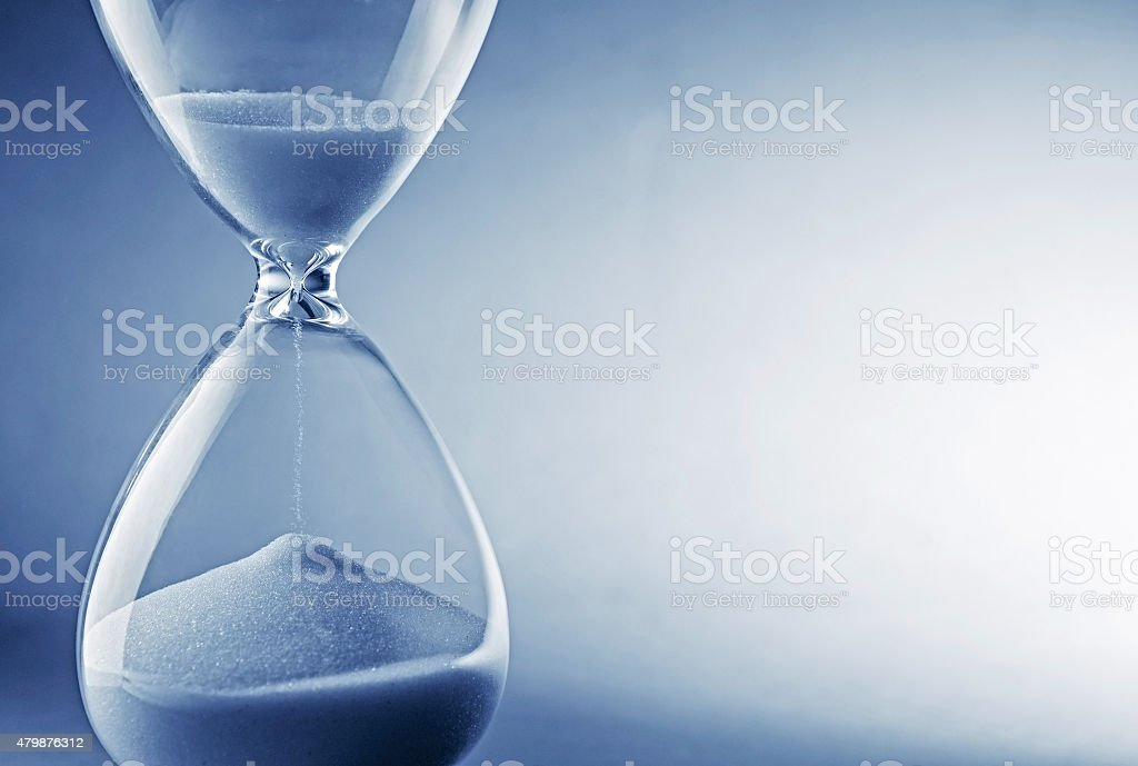 Hourglass clock on light blue background stock photo