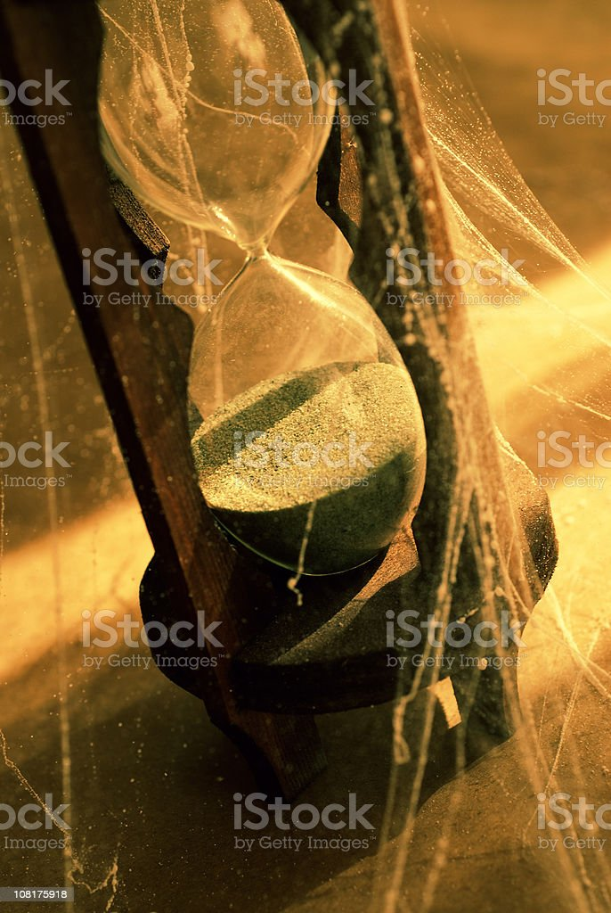 Hourglass Covered in Cobwebs royalty-free stock photo