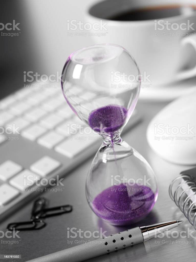 Hourglass in a Office royalty-free stock photo