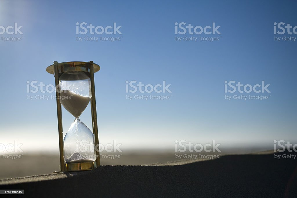 Hourglass on a Sand Dune stock photo