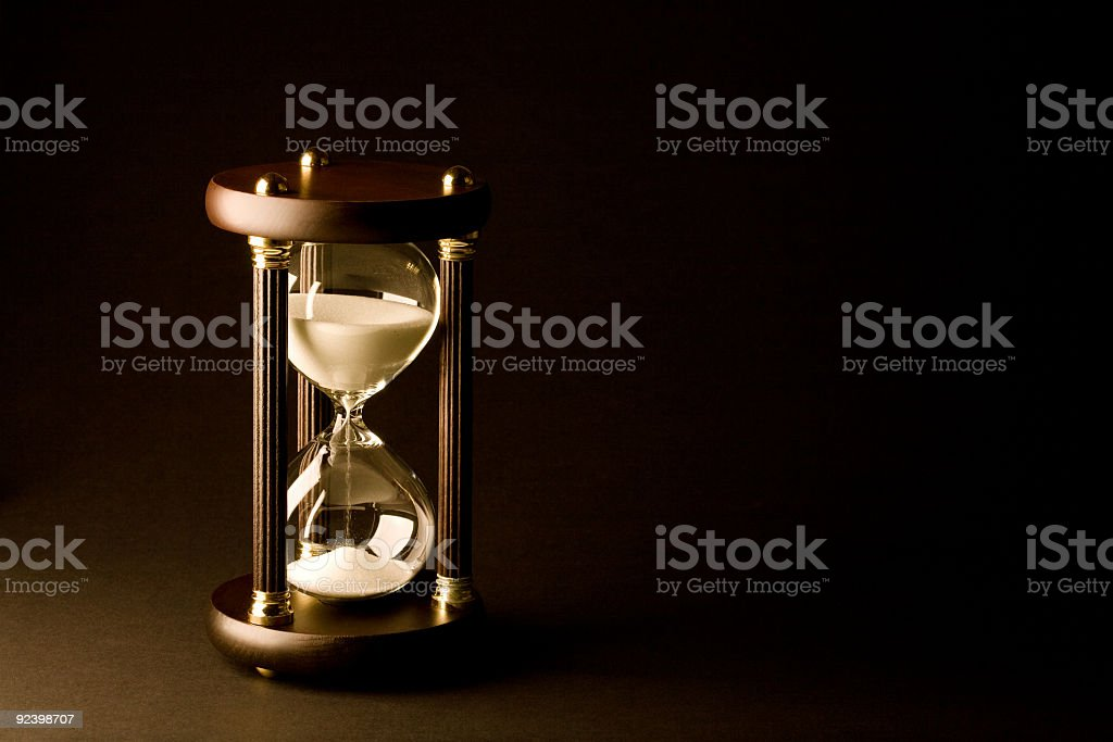 Hourglass on Black stock photo