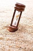 hourglass on sand background