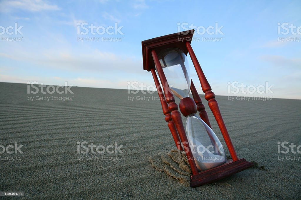 Hourglass on the dune. stock photo