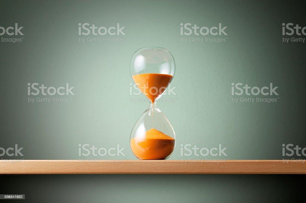 Hourglass on the shelf.