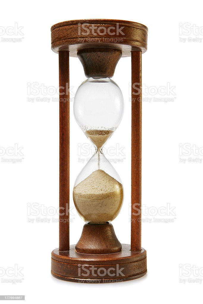 Hourglass running out of time stock photo