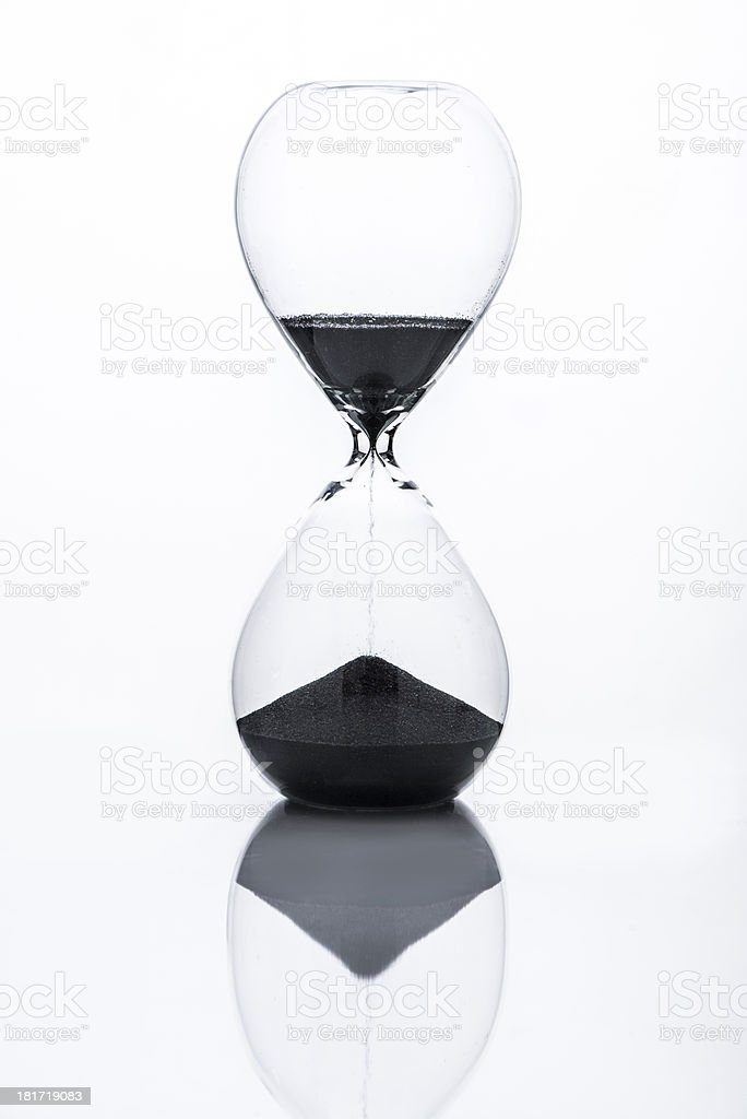 Hourglass with black sand royalty-free stock photo
