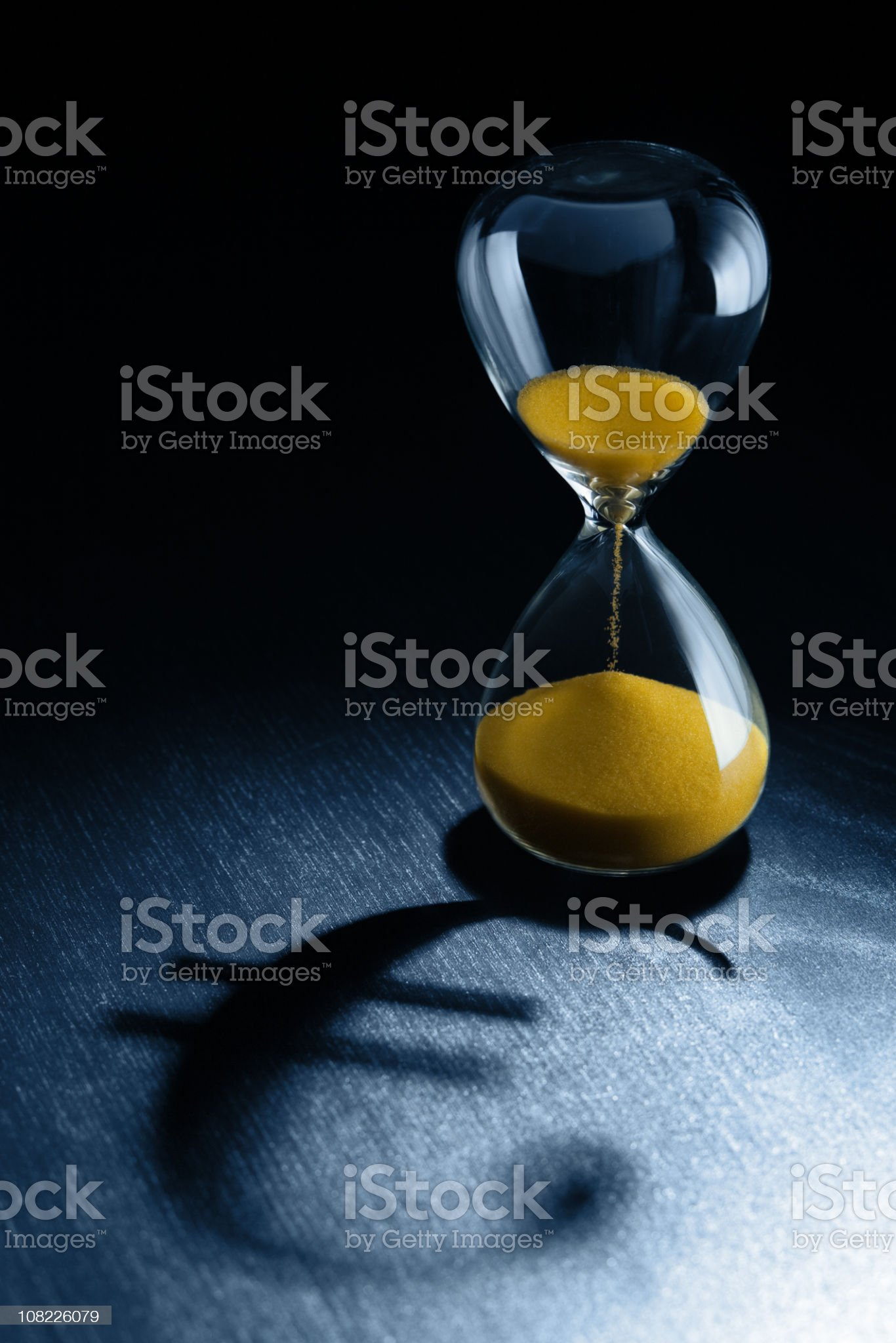 Hourglass with Euro Symbol Shadow royalty-free stock photo