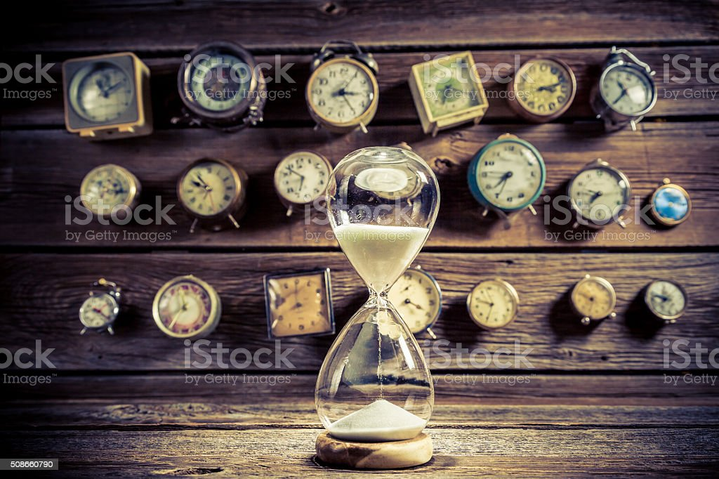 Hourglass with flowing sand stock photo
