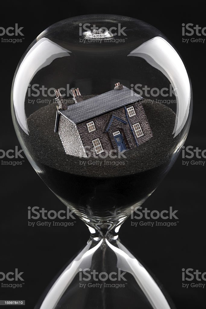 Hourglass with house inside. Housing market collapse concept stock photo