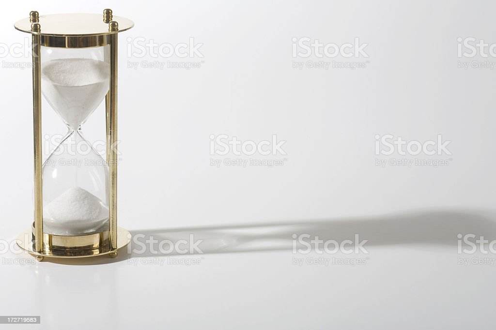 Hourglass with long shadow royalty-free stock photo