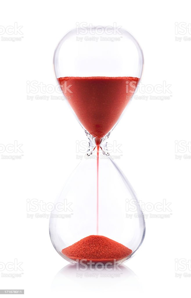 Hourglass with red sand on white background - Time concept stock photo