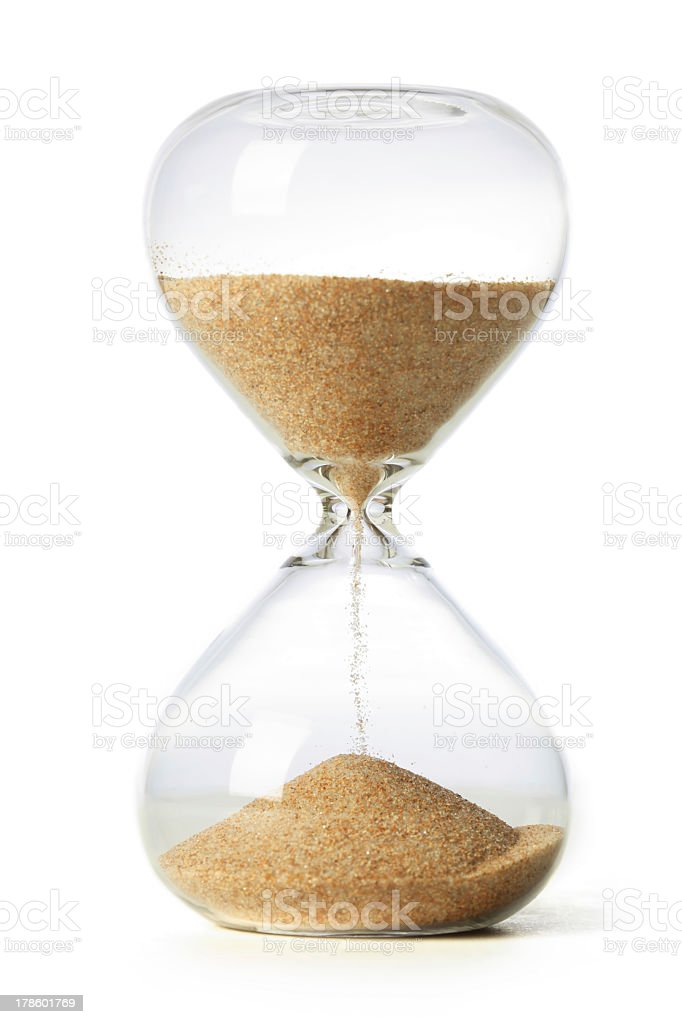 Hourglass with sand running out on a white background stock photo
