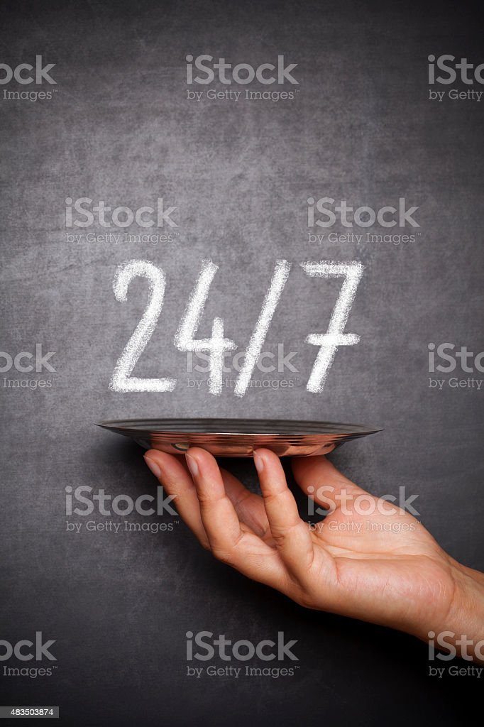 24 hours a day and 7 days a week stock photo