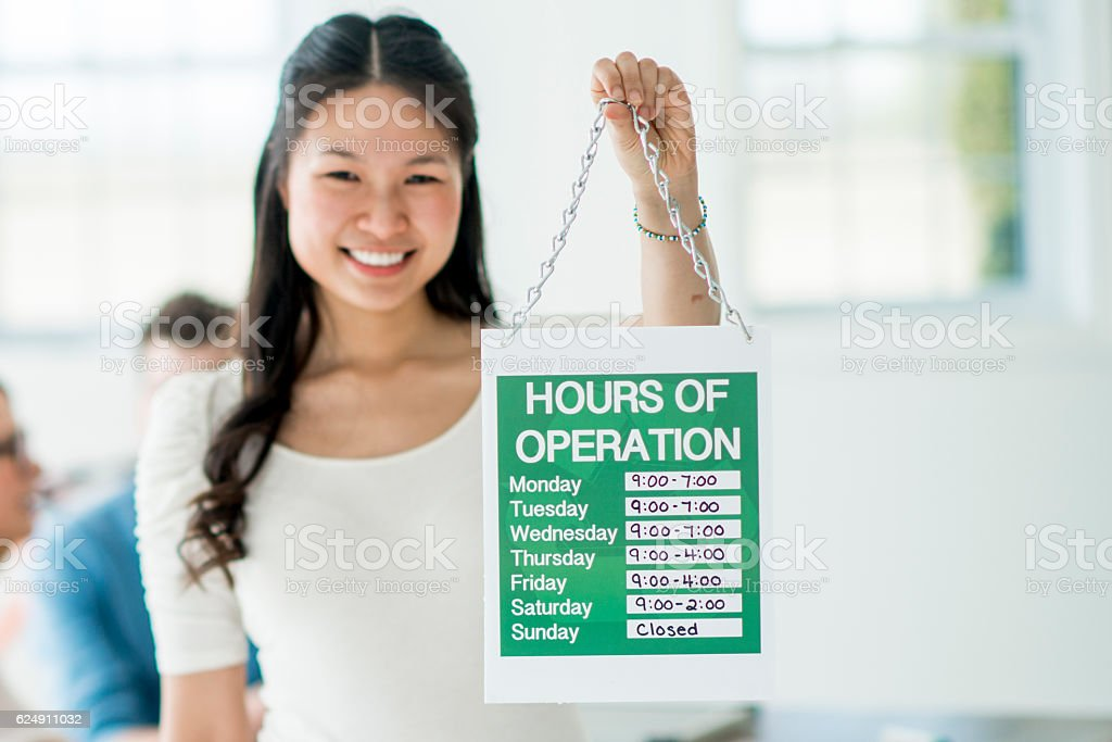 Hours of Operation Sign stock photo