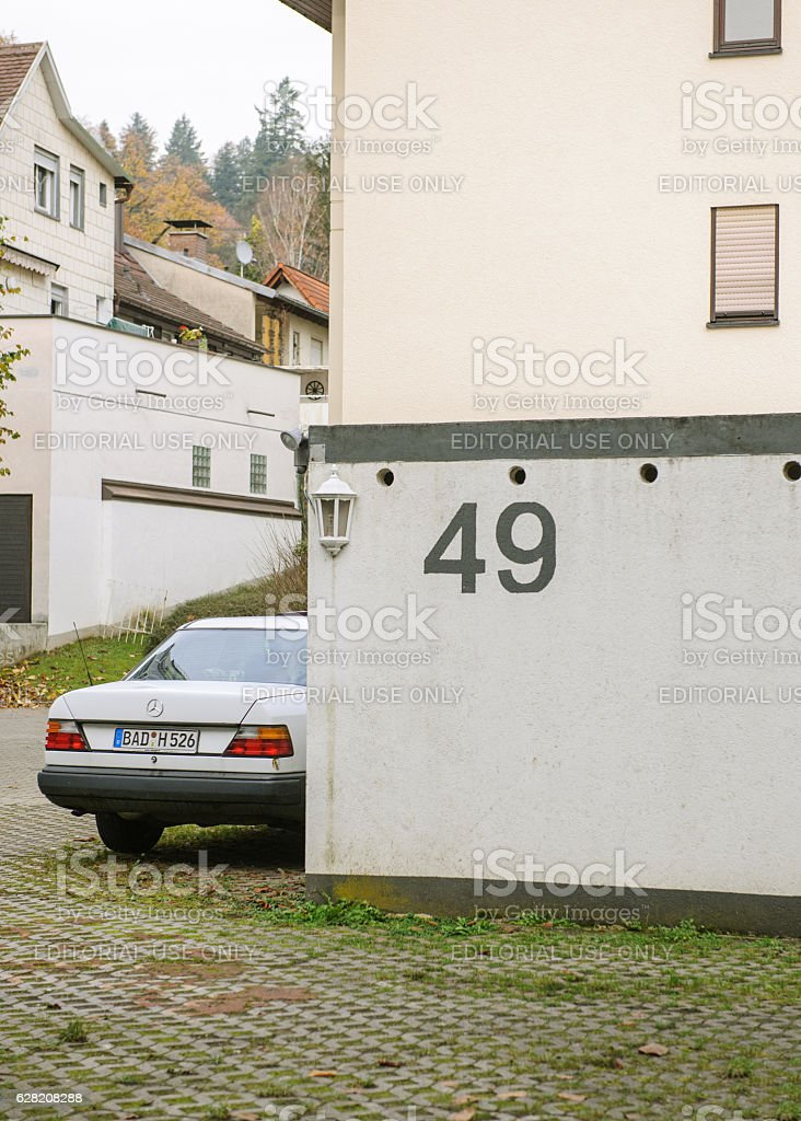 House 49 and vintage Mercedes-Benz car stock photo