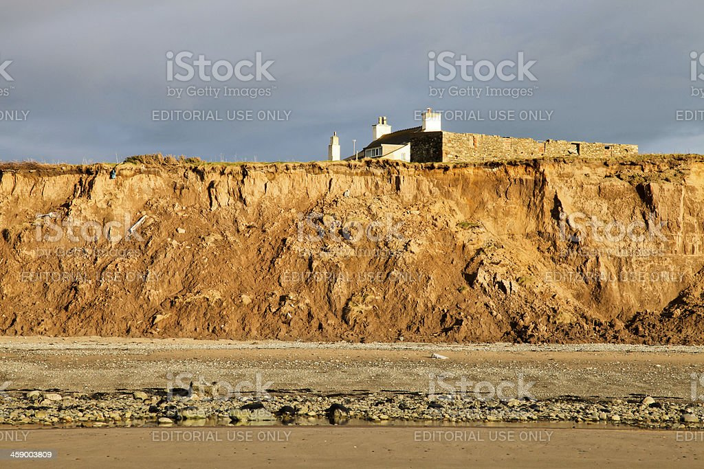 House Affected by Coastal Erosion royalty-free stock photo
